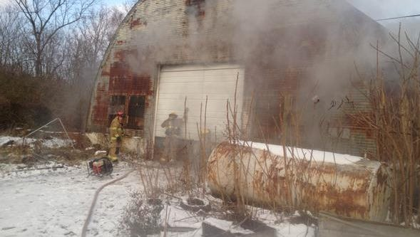 Firefighters battled a fire in three storage buildings Thursday afternoon.