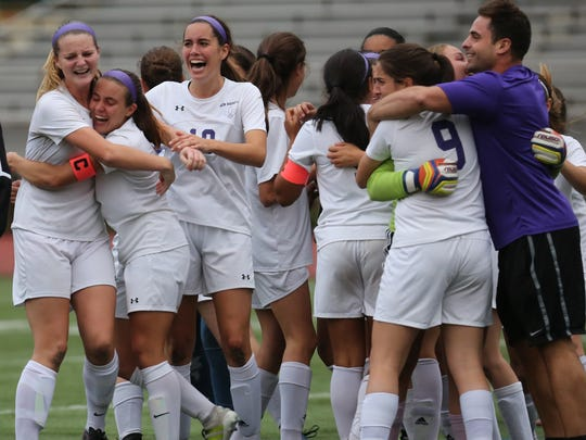 New Rochelle celebrates their  4-3, win over Scarsdale