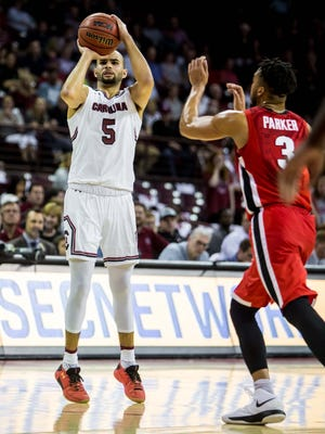 South Carolina Gamecocks guard Frank Booker (5) shoots over Georgia Bulldogs guard Juwan Parker (3) in the first half Wednesday night at Colonial Life Arena in Columbia.