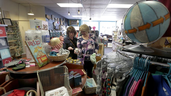Connie Zimmerman, left, and Cindy Hegglund shop at Blue Moon Emporium in downtown Appleton. It's one of the small shops readers said was worth a visit on Small Business Saturday.