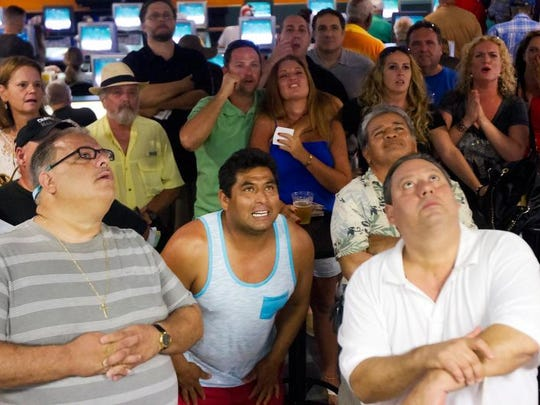 Horse racing fans watch the 2014 Belmont Stakes on Saturday at the Naples-Fort Myers Greyhound Track in Bonita Springs. Tonalist upset California Chrome in the race.