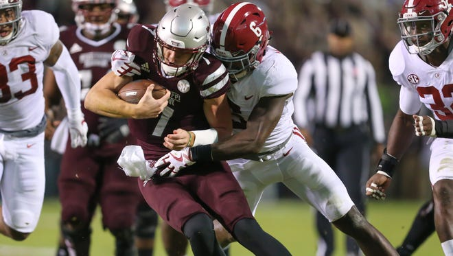 Mississippi State's Nick Fitzgerald (7) is wrapped up by Alabama's Hootie Jones (6) after a gain Saturday in Starkville.