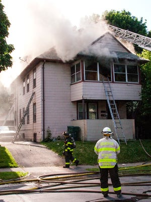Smoke showing from a large 2.5-story home on Minder Street on May 28, 2015..