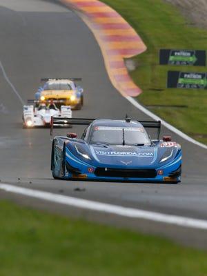 The Visit Florida Racing Corvette Daytona Prototype on its way to victory in the 2015 Sahlen's Six Hours of  the Glen at  Watkins Glen International.