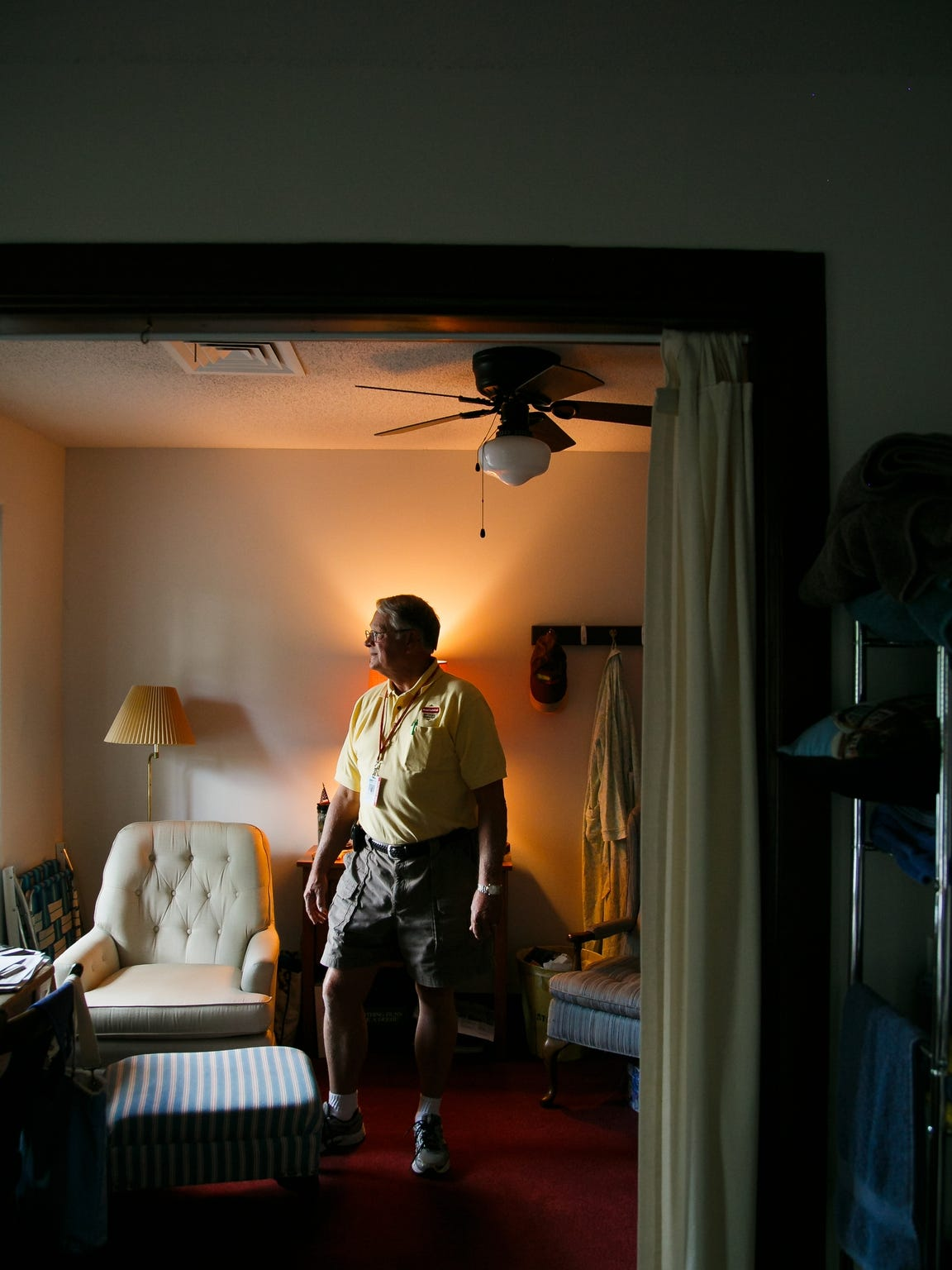 Iowa State Fair Board member Jerry Parkin stands inside his dorm room on the second floor of the Administration Building.