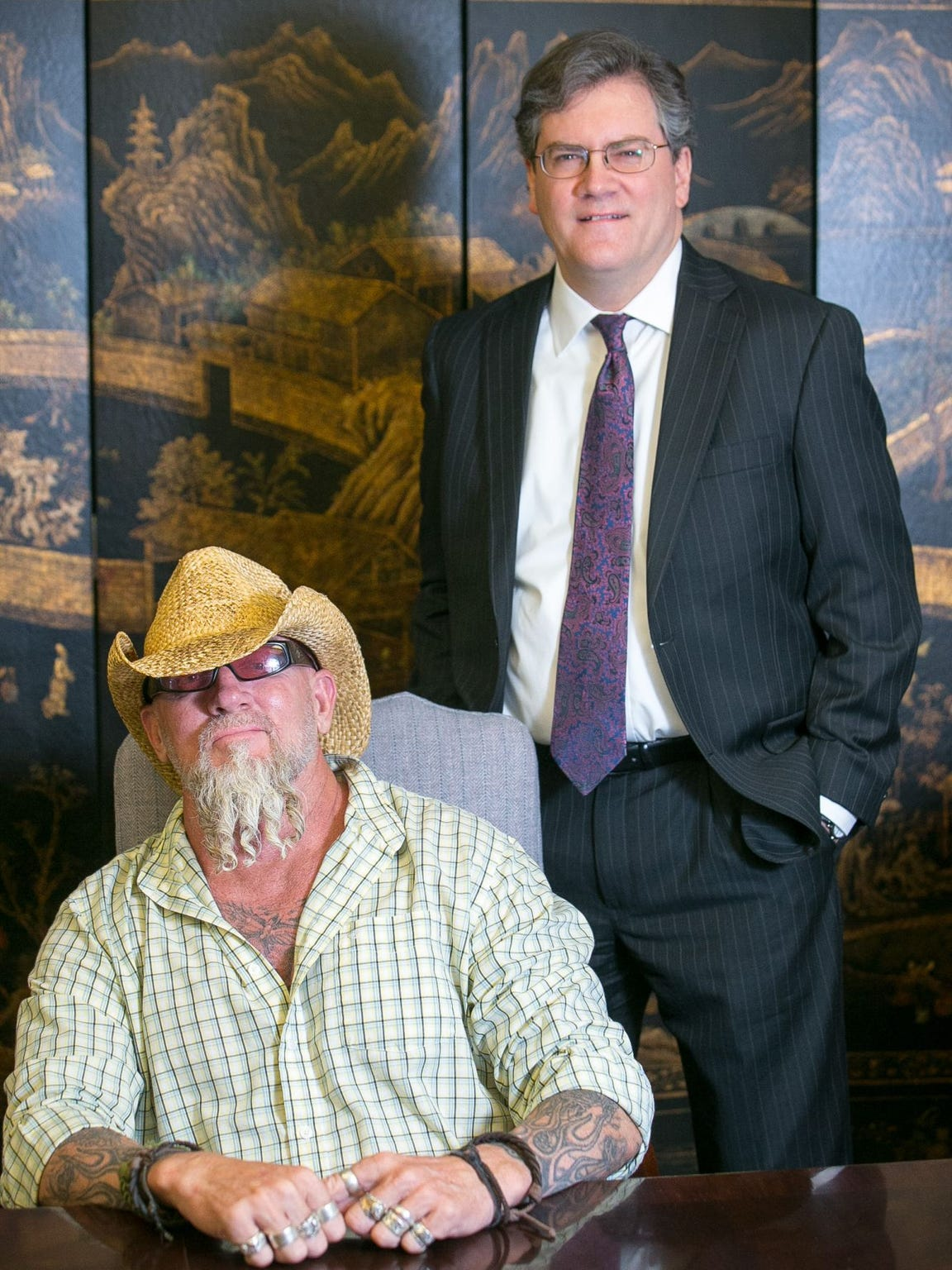 Former federal agent Jay Dobyns, left, with his attorney