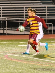 Ithaca's Pierre Clavel takes control of the ball Monday.