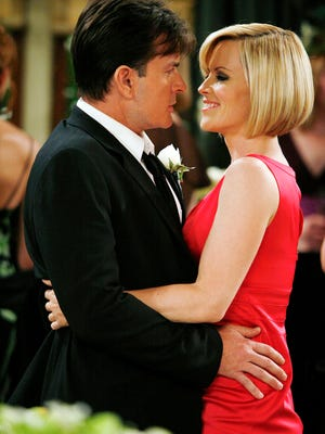Charlie (Charlie Sheen) with his new step-sister, Courtney (special guest star Jenny McCarthy), on 'Two and a Half Men.' The episode aired in 2008.