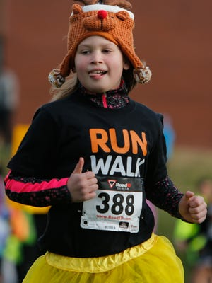 Abby Miles, 9, runs during the 45th Annual Turkey Trot on Thanksgiving.
