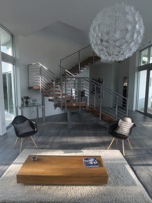 The staircase provides interesting angles separating the public living space of the home, wrapped in glass, from the private bedrooms.