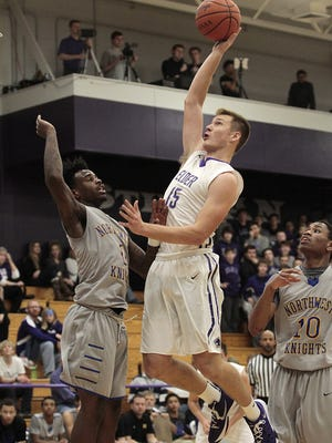 Nick Hall gets some extension as he puts up a nice shot from the paint. Elder plays just its second game of the season against road-tested Northwest Friday night, December 11th, 2015.