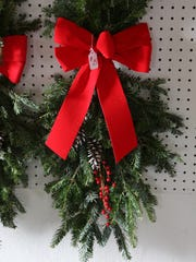 A door decoration hangs on a wall at Walnut Ridge Farm in Indianola.
