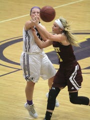 Indianola junior Ellie Jensen gets a pass past Ankeny junior Codee Myers. Class 5-A fifth-ranked Indianola beat Ankeny 52-47 in Indianola on Dec. 15.