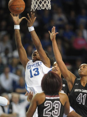 UK's Evelyn Akhator puts up the ball during the University of Kentucky womens basketball game against South Carolina at Memorial Coliseum in Lexington, Ky., on Thursday, January 14, 2015. 