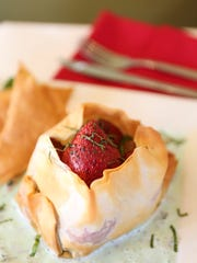The baked strawberry purse dessert with mint sauce