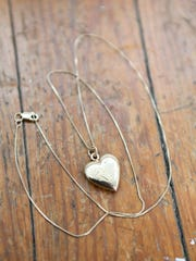 This gold heart pendant necklace was a given to her when she was 16 by her grandmother. March 7, 2016