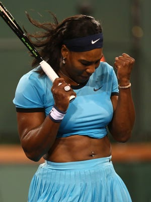 American Serena Williams celebrates after scoring on defending champion Simona Halep of Romania in the second set on Wednesday, March 16, 2016 during the BNP Paribas Open in Indian Wells, Calif. Williams won in straight sets, 6-4, 6-3.