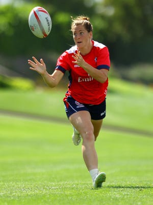Megan Bonny, a member of the USA Women's Eagles Sevens national rugby team, passes the ball during phase play on Tuesday, March 22, 2016 while practicing at the Vintage Club in Indian Wells, Calif. The team practiced in Indian Wells as a fundraiser hosted by individual members of the club. Members of the team will represent the USA this summer during the Olympics in Rio de Janeiro. During phase play, team members scrimmaged against each other to work on defensive tactics.