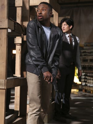 Detective Carter (Justin Hires) and Detective Lee (John Foo) are on the case in 'Rush Hour.'