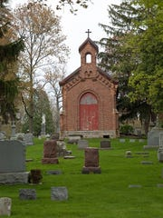 Many of the graves around the chapel in Allouez Cemetery are as old as the 140-year-old crumbling structure.