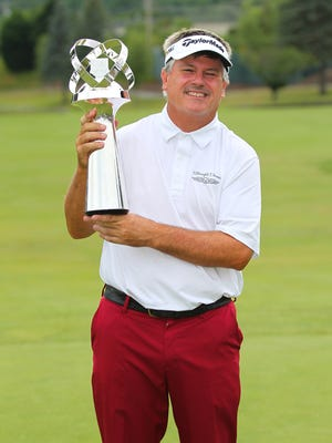 Paul Goydos with the winner's trophy from the 10th annual Dick's Sporting Goods Open on Sunday, June 10