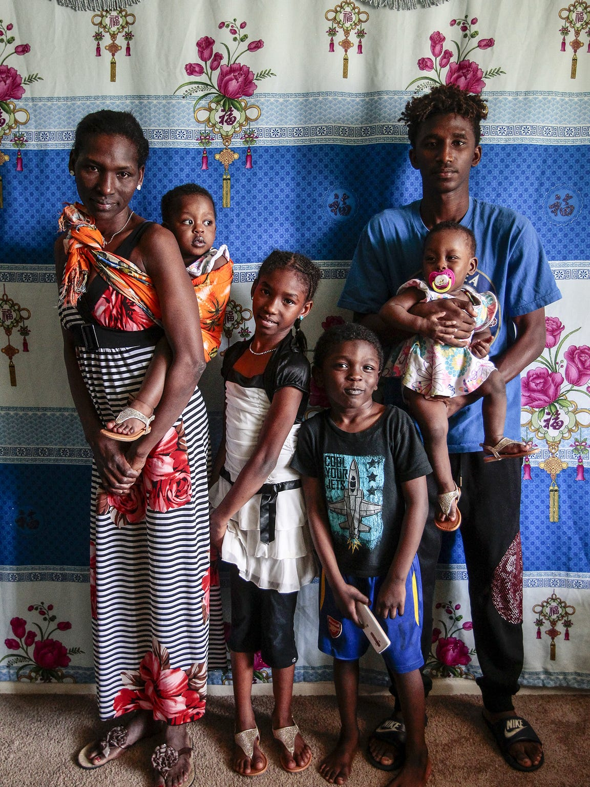 Dawit Ajju with his family, mother, Hawa Tanni; sister,