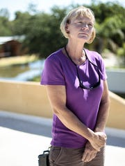 Tanis Earle looks on at her home in south Phoenix near
