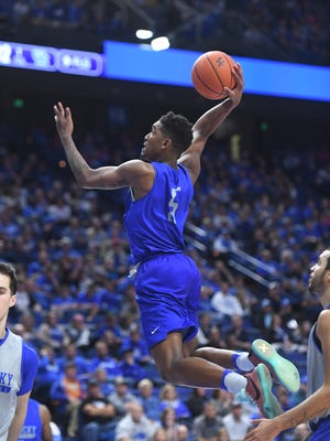 UK's Malik Monk goes up for a dunk during the University of Kentucky Blue-White basketball scrimmage at Rupp Arena in Lexington, KY on Friday, October 21, 2016.