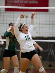 D.C. Everest libero Teilyn Schubring, celebrates after scoring against Marshfield in a Division 1 sectional semifinal at SPASH on Thursday night.