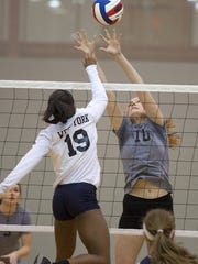West York's Tesia Thomas (No. 19) battles York Suburban's Parker Faircloth-Henise at the net earlier this month.