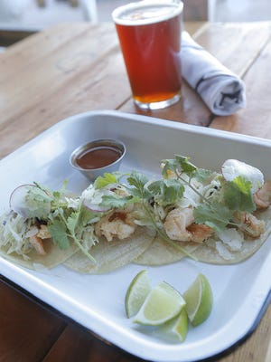 MARK LAMBIE / EL PASO TIMES Ode Brewing?s Shrimp Tacos pair nicely with their in-house-brewed Amber Lager. The restaurant/brewery offers a full, sophisticated, yet laid-back menu. The beer at Ode is hand-crafted by Brew Master Albert Salinas. Ode Brewing's Shrimp Tacos pair nicely with their in-house-brewed Amber Lager. The restaurant/brewery offers a full, sophisticated, yet laid-back menu. The beer at Ode is hand crafted by Brew Master Albert Salinas.