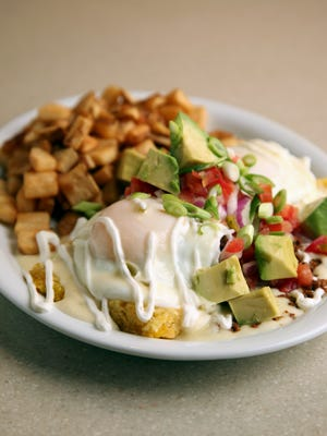 Oakley Station's Wild Eggs location will open on Jan. 9. They serve the Calamity Katie Border Benedict, green chili cheddar corn cakes, topped with chorizo, two poached eggs and queso fundido, pico de gallo, sour cream, green onion and fresh avocado.
