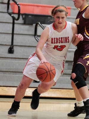 Teagan Vogel drives along the baseline for the Anderson Redskins.  Anderson takes on their rival Turpin on Saturday afternoon, January 7, 2016.