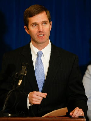 Attorney General Andy Beshear speaks during a Survivors Council press conference in the Capitol Rotunda on Monday. Jan. 30, 2017