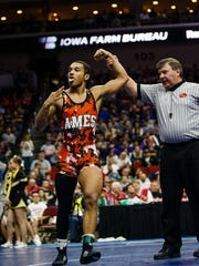 Ames senior Marcus Coleman celebrates his third straight state title after winning the 170 pound championship match at the Iowa high school state wrestling tournament on Saturday, Feb. 18, 2017 in Des Moines.