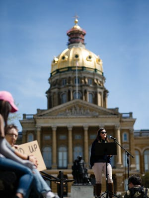 Farmer and social media personality Michelle Miller speaks during the March for Science on the steps of the the capitol building on Saturday, April 22, 2017, in Des Moines.