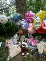 A memorial at the spot where Tyrisha Bills Hamilton, 37, was killed when her car veered off Highway 303 on Wednesday morning.