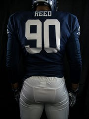 Malik Reed shows off Nevada's new uniforms.