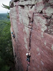 Climbers scale the cliffs at Devil's Lake State Park on a trip with Devils Lake Climbing guides.