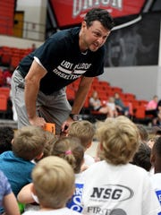 Union University head women's basketball coach Mark Campbell talks to pee wee campers at the conclusion of day one of their summer basketball camp, Monday, June 5.