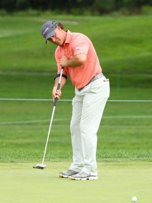 Scott McCarron putts on his way to an 11-under-par 61 Saturday of the 2017 Dick's Sporting Goods Open at En-Joie Golf Club in Endicott.