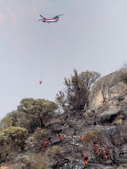 Firefighters from the U.S. Forest Service and Tulare