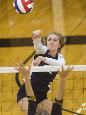 Dallastown's Lydia Stump, center, returns the ball. Dallastown defeated Red Lion 3-1 in girls' volleyball at Red Lion Area Senior High School Tuesday.