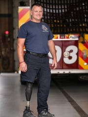 Lt. Brandon Anderson wears modified uniform pants (removed from the right-knee-down for the photo) that allow him to change for emergency runs faster, seen at Fishers Fire Department station 93, Fishers, Ind., Wednesday, Sept. 6, 2017. Anderson lost his right leg in a motorcycle accident in August of 2016, and returned to work at the Fishers Fire Department in May of 2017, with an above-the-knee prosthetic leg. Anderson has passed physical agility tests and is able to perform his medical, firefighting and emergency duties as efficiently as before the accident.