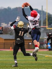 Connor Borchardt makes a leaping catch for Chenango