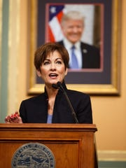 Gov. Kim Reynolds address the Iowa Legislature during