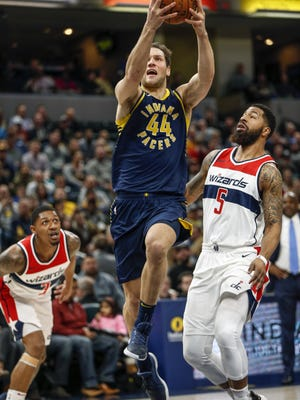 Indiana Pacers forward Bojan Bogdanovic (44) drives against Washington Wizards forward Markieff Morris (5) for the make at Bankers Life Fieldhouse on Monday, Feb. 5, 2018.
