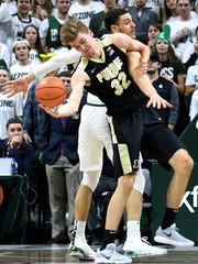 Michigan State's Gavin Schilling, right, and Purdue's