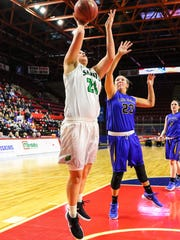 Marina Maerkl scores inside for Seton Catholic Central during its 69-51 Section 4 Class A title-game victory over Maine-Endwell on Saturday at the Floyd L. Maines Veterans Memorial Arena. Maerkl scored 18 points.