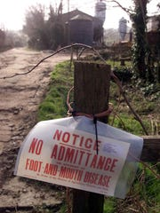 A sign is seen outside Farringford Farm at Freshwater Bay on the Isle of Wight, England  Feb. 21 2001, where Ministry of Agriculture officials are investigating the possibility of an outbreak of foot-and-mouth disease.